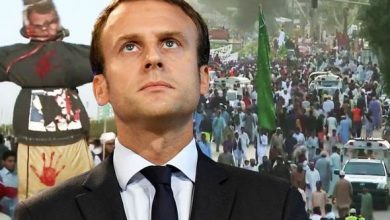 Photo of French President attempts to diffuse cartoon fiasco